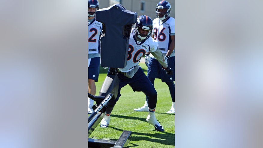 FILe - In this May 28, 2014 file photo, Denver Broncos' Julius Thomas runs a drill during an NFL football organized team activity in Englewood, Colo. The 6-foot-5, 255-pound late-bloomer became a bulls-eye for some of Peyton Manning's biggest moments last year, like when he caught his 51st TD throw that broke Tom Brady's single-season record, one of a dozen touchdown passes he caught last year, breaking Hall of Famer Shannon Sharpe's team record for tight ends. (AP Photo/Jack Dempsey, File)