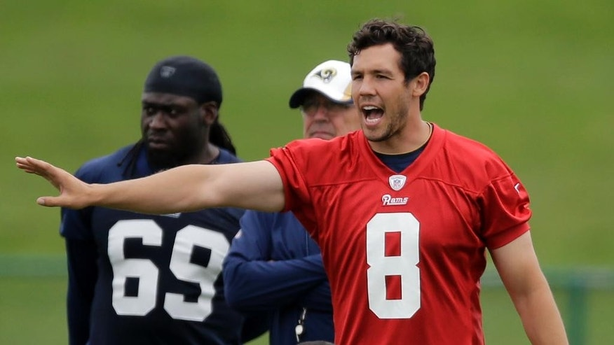 St. Louis Rams quarterback Sam Bradford calls out at the line of scrimmage during an organized team activity at the NFL football team's practice facility Thursday, June 5, 2014, in St. Louis. (AP Photo/Jeff Roberson)