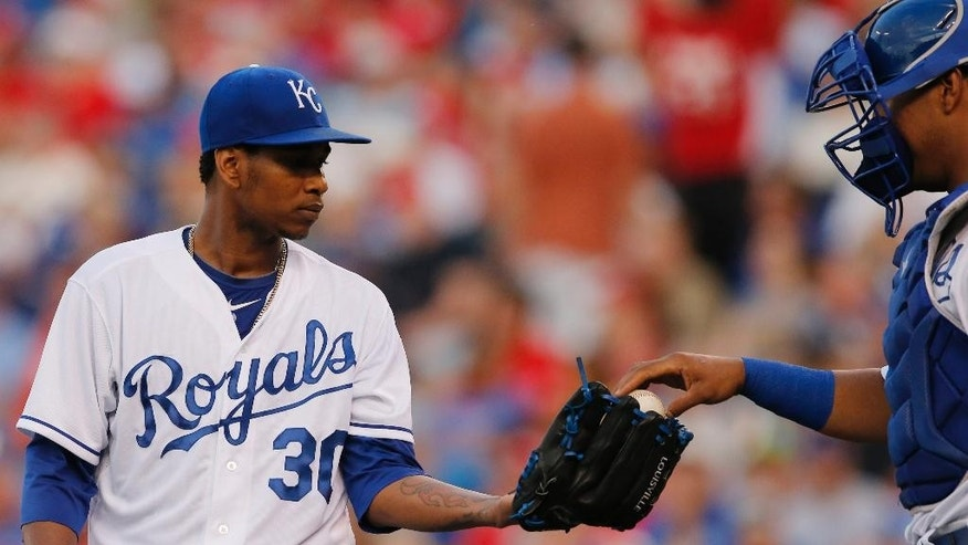 Kansas City Royals starting pitcher Yordano Ventura (30) takes a ball from catcher Salvador Perez, right, after giving up a run in the fourth inning of a baseball game against the St. Louis Cardinals at Kauffman Stadium in Kansas City, Mo., Thursday, June 5, 2014. (AP Photo/Orlin Wagner)