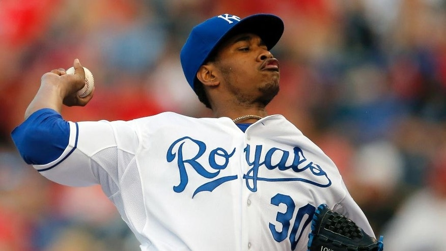 Kansas City Royals starting pitcher Yordano Ventura delivers to a St. Louis Cardinals batter during the first inning of a baseball game at Kauffman Stadium in Kansas City, Mo., Thursday, June 5, 2014. (AP Photo/Orlin Wagner)