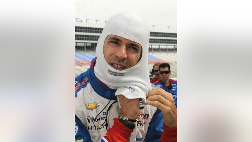 Helio Castroneves, of Brazil, prepares for IndyCar auto racing practice at Texas Motor Speedway in Fort Worth, Friday, June 6, 2014. (AP Photo/Larry Papke)