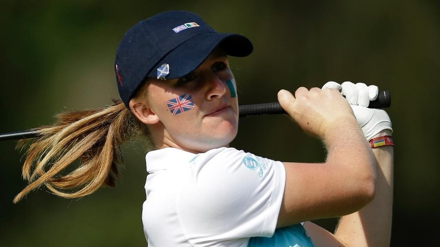 Great Britain and Ireland's Gemma Dryburgh tees off on the sixth hole during the 38th Curtis Cup amateur golf match against the United States Friday, June 6, 2014, in St. Louis. (AP Photo/Jeff Roberson)
