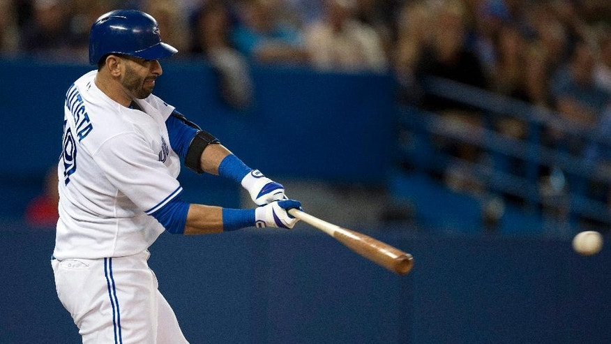 Toronto Blue Jays Jose Bautista hits into a triple play against the St. Louis Cardinals during the sixth inning of a baseball game in Toronto on Friday, June 6, 2014. (AP Photo/The Canadian Press, Frank Gunn)