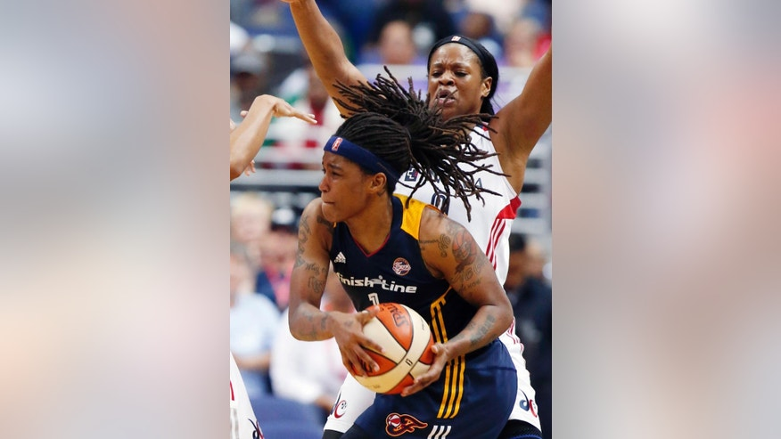 Indiana Fever guard Shavonte Zellous (1) looks to pass as she is guarded by Washington Mystics center Kia Vaughn (9) during the first half of a WNBA basketball game Friday, June 6, 2014 in Washington.  (AP Photo/Alex Brandon)