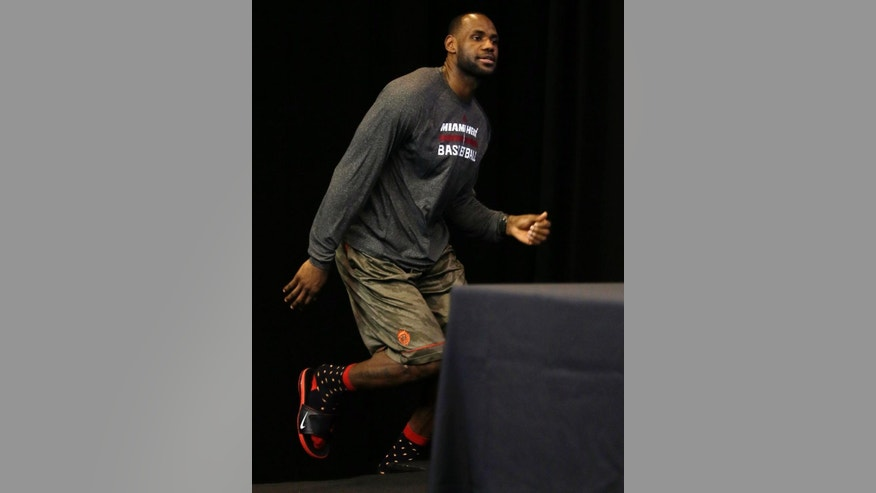 Miami Heat forward LeBron James arrives for a news conference on Friday, June 6, 2014, in San Antonio. The team plays Game 2 of the NBA Finals against the San Antonio Spurs on Sunday. (AP Photo/Tony Gutierrez)