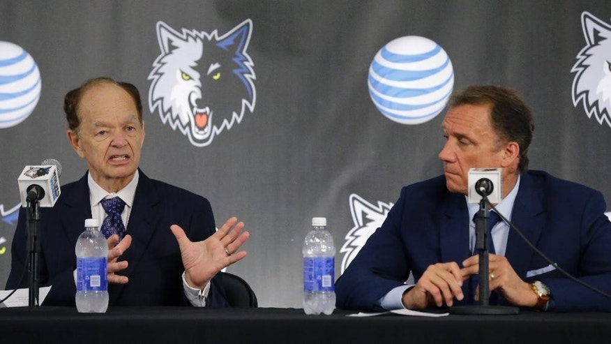 Minnesota Timberwolves  team president of basketball operations and new head coach Flip Saunders, right, listens as team owner Glen Taylor, left, responds to a question during a media availability in Minneapolis, Friday, June 6, 2014.  (AP Photo/Ann Heisenfelt)