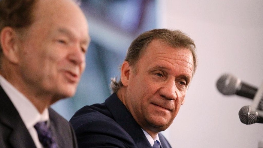 Minnesota Timberwolves team president of basketball operations and new head coach Flip Saunders, right, listens to comments by team owner Glen Taylor, left, during a media availability in Minneapolis, Friday, June 6, 2014.  (AP Photo/Ann Heisenfelt)