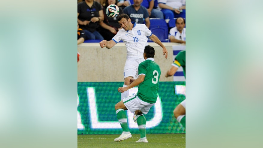 Greece's Vasileios Torosidis (15) goes up for a header over Bolivia's Luis Alberto Gutierrez Herrera during the first half of an international friendly soccer match Friday, June 6, 2014, in Harrison, N.J.. (AP Photo/Bill Kostroun)