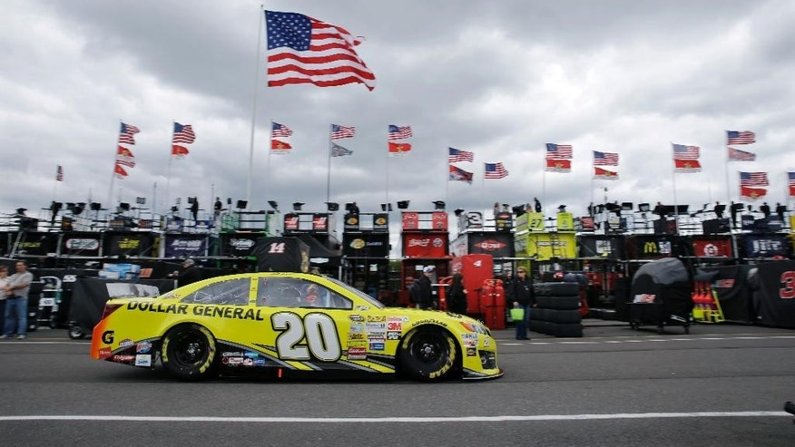 NASCAR Sprint Cup Series driver Matt Kenseth drives in the garage area at Pocono Raceway before practice for Sunday's NASCAR Sprint Cup Series auto race in Long Pond, Pa., Friday, June 6, 2014. (AP Photo/Mel Evans)