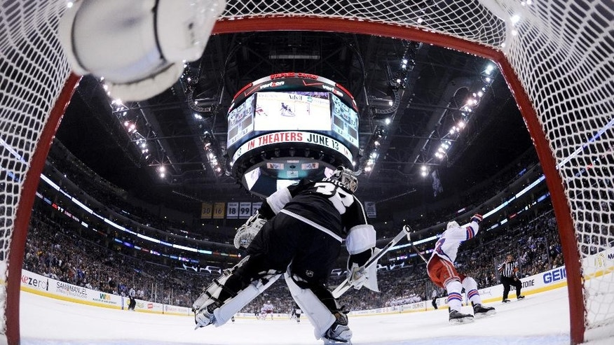 New York Rangers' Benoit Pouliot, right,  scores a first period goal against Los Angeles Kings goalie Jonathan Quick  during Game One of the 2014 NHL Stanley Cup Final at the Staples Center on June 4, 2014 in Los Angeles. (AP Photo/Bruce Bennett, Pool)