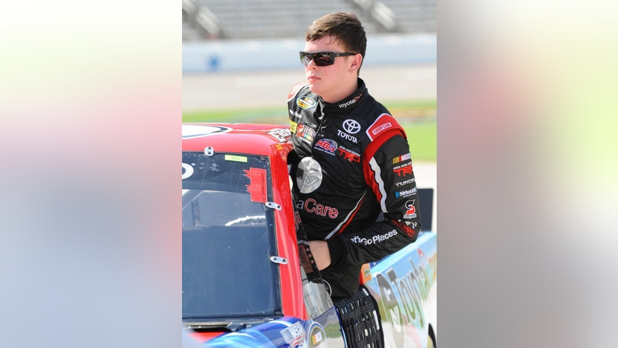 Erik Jones gets into his truck before qualifying for a NASCAR truck race at Texas Motor Speedway in Fort Worth, Friday, June 6, 2014. Tonight's race falls on the same day as Jone's high school senior  graduation however, he chose to forego the opportunity to walk across the stage with his fellow classmates to drive in the race. (AP Photo/Ralph Lauer)