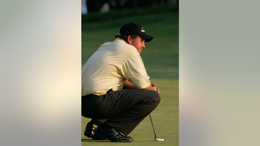 ADVANCE FOR WEEKEND EDITIONS, JUNE 7-8 - FILE - In this June 18,2 006, file phot, Phil Mickelson reacts after missing a putt for bogey on 18 in the final round of the U.S. Open at Winged Foot Golf Club in Mamaroneck, N.Y. Mickelson doble bogeyed the hole. No one has ever had so many chance in one major without ever winning it. Somehow, Mickelson is as optimistic as ever.  (AP Photo/Morry Gash, File)