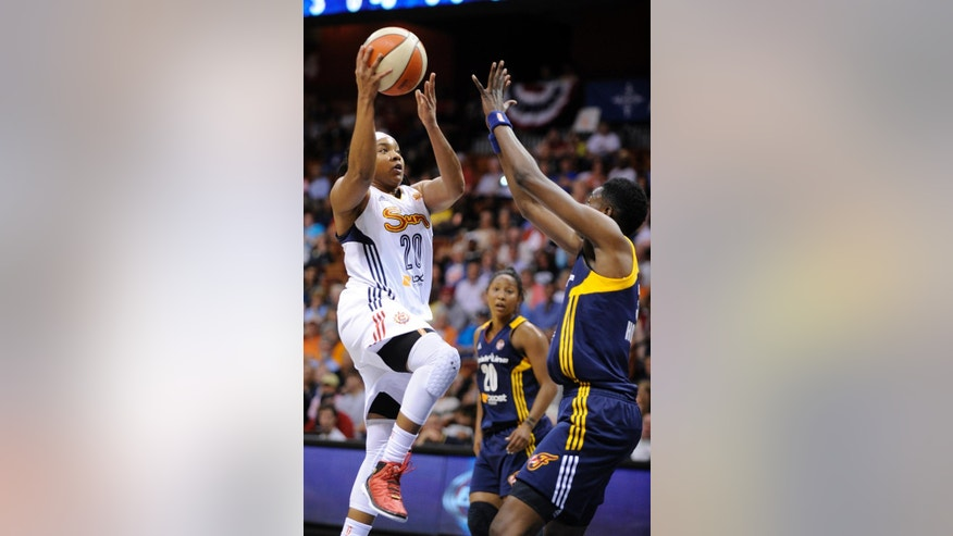 Connecticut Sun's Alex Bentley (20) drives past Indiana Fever's Natasha Howard (33) during the first half of their WNBA basketball game in Uncasville, Conn., Saturday, June 7, 2014. (AP Photo/Fred Beckham)