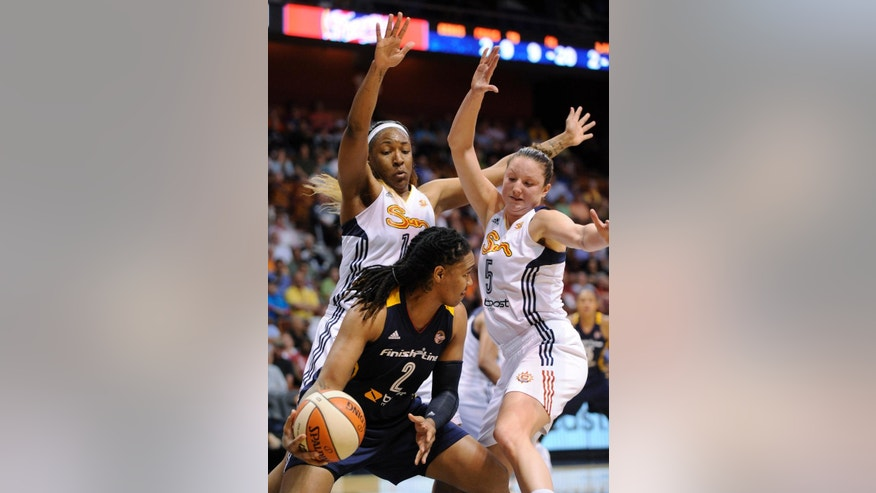 Indiana Fever's Erlana Larkins (2) is guarded by Connecticut Sun's Kelsey Bone, left, and Connecticut Sun's Kelsey Griffin (5) during the first half of their WNBA basketball game in Uncasville, Conn., Saturday, June 7, 2014. (AP Photo/Fred Beckham)