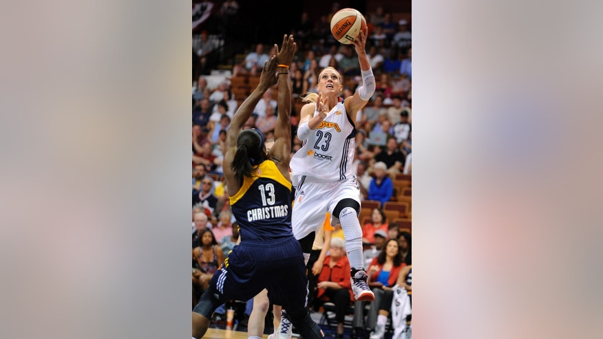 Connecticut Sun's Katie Douglas (23) drives past Indiana Fever's Karima Christmas (13) during the first half of their WNBA basketball game in Uncasville, Conn., Saturday, June 7, 2014. (AP Photo/Fred Beckham)