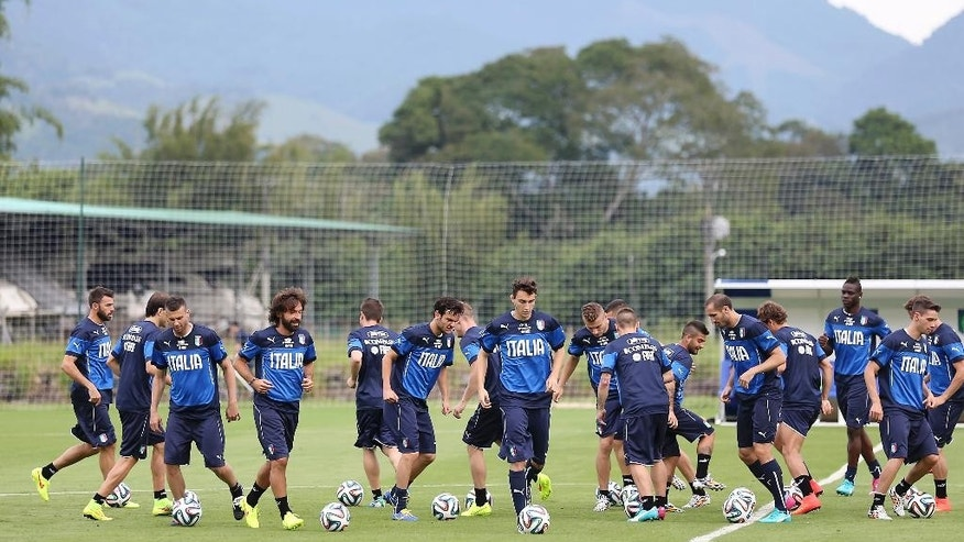 Italy players control the ball during a training session of Italy in Mangaratiba, Brazil, Saturday, June 7, 2014. Italy play in group D of the 2014 soccer World Cup. (AP Photo/Antonio Calanni)