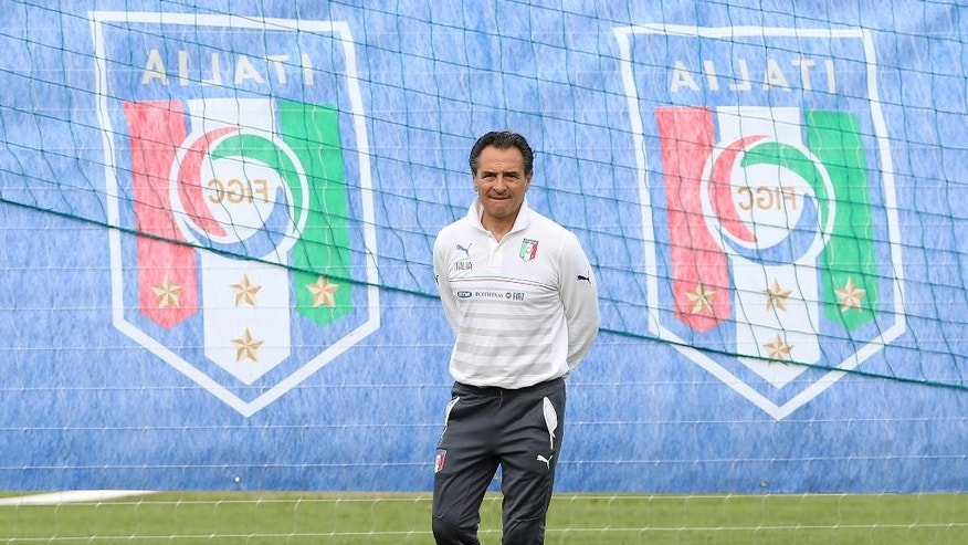 Italy coach Cesare Prandelli watches his players during a training session of Italy in Mangaratiba, Brazil, Saturday, June 7, 2014. Italy play in group D of the 2014 soccer World Cup. (AP Photo/Antonio Calanni)