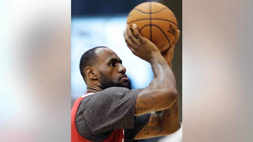 Miami Heat forward LeBron James shoots the ball during practice on Saturday, June 7, 2014, in San Antonio. The team plays Game 2 of the NBA Finals against the San Antonio Spurs on Sunday. (AP Photo/Eric Gay)