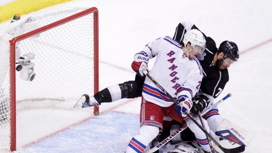 Los Angeles Kings left wing Dwight King, middle, scores between New York Rangers defenseman Ryan McDonagh, left, and goalie Henrik Lundqvist, of Sweden, during the third period of Game 2 in the NHL Stanley Cup Final hockey series in Los Angeles, Saturday, June 7, 2014. (AP Photo/Jae C. Hong)