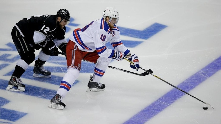 Los Angeles Kings right wing Marian Gaborik, of Slovakia, left, battles New York Rangers defenseman Marc Staal for the puck during the third period of Game 2 in the NHL hockey Stanley Cup Finals in Los Angeles, Saturday, June 7, 2014. (AP Photo/Jae C. Hong)