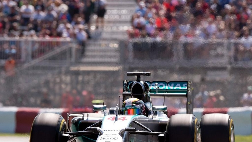 Mercedes driver Lewis Hamilton from Great Britain during the morning practice session Saturday, June 7, 2014 at the Canadian Grand Prix in Montreal. (AP Photo/The Canadian Press, Jacques Boissinot)