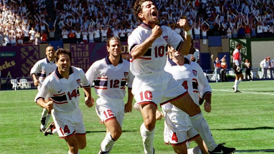FILE - In this Sept. 7, 1997 file photo, U.S. National soccer team midfielder Tab Ramos (10) is followed by teammates as he celebrates his game-winning goal during their World Cup final round qualifying game against Costa Rica in Portland, Ore. While Ramos was a central figure in the early days of the current American streak of qualifying for seven straight World Cups, playing in the first three of those from 1990-98, it wasn't until 2006 that the U.S. Soccer Federation began to study its development system in earnest. (AP Photo/Don Ryan, File)