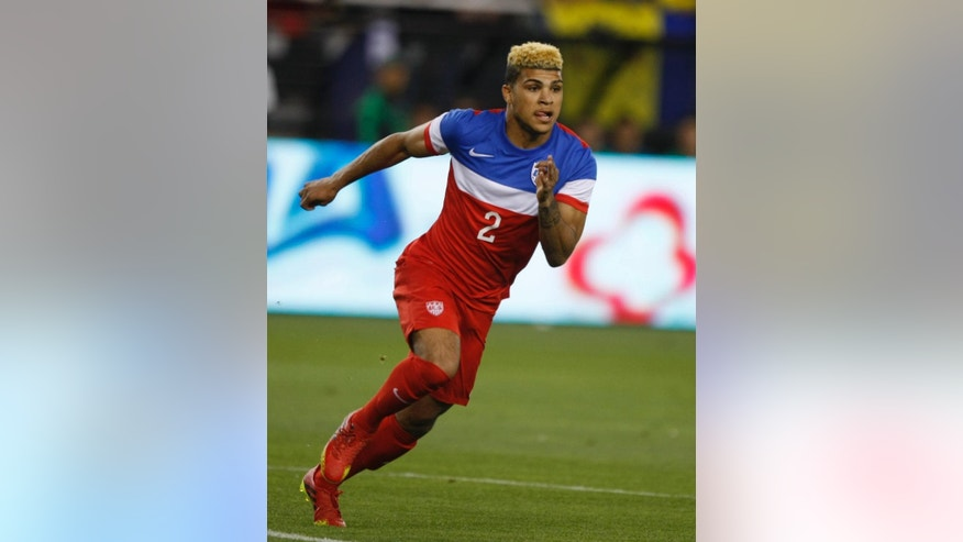 FILE - In this April 2, 2014 file photo, U.S. defenseman DeAndre Yedlin (2) moves down field against Mexico during the second half of an international friendly soccer match in Glendale, Ariz. Yedlin was named to the current 23-man roster by coach Jurgen Klinsmann two weeks ago, doing so after spending his amateur years as a member of the Seattle Sounders FC Academy team. (AP Photo/Rock Scuteri, File)