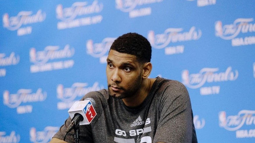 San Antonio Spurs forward Tim Duncan listens to a question during a news conference on Saturday, June 7, 2014, in San Antonio. The team plays Game 2 of the NBA Finals against the Miami Heat on Sunday. (AP Photo/Eric Gay)