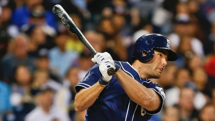 San Diego Padres' Seth Smith collects his second hit of the game with a line drive single to right that would lead to a run against the Washington Nationals during the fourth inning of a baseball, game Saturday, June 7, 2014, in San Diego. (AP Photo/Lenny Ignelzi)