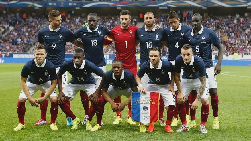 French soccer team players pose before the international friendly match between France and Jamaica at the Lille Metropole stadium, in Villeneuve d'Ascq, northern France, Sunday, June 8, 2014. From left background: Olivier Giroud, Moussa Sissoko, Hugo Lloris, Karim Benzema, Raphael Varane, Mamadou Sakho, and foreground from left, Yohan Cabaye, Blaise Matuidi, Patrice Evra, Mathieu Valbuena and Mathieu Debuchy, as France prepare for the upcoming FIFA soccer World Cup in Brazil starting on 12 June. (AP Photo/Jacques Brinon)