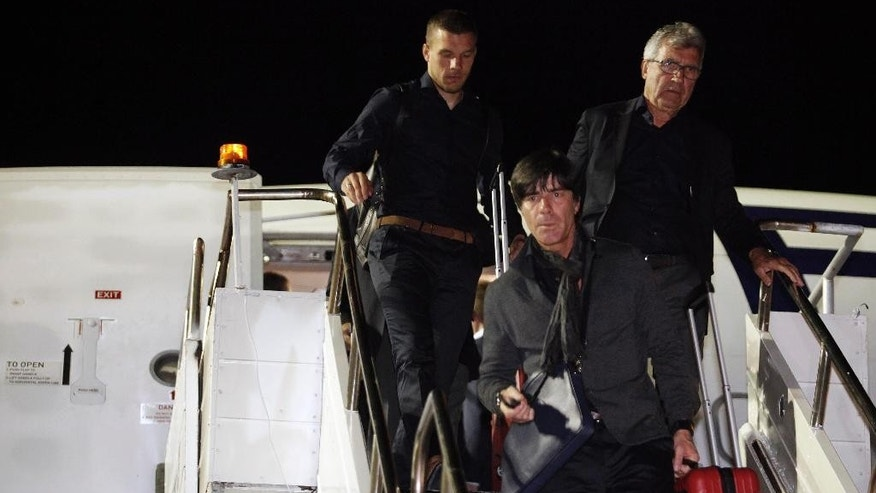 Germany's coach Joachim Loew, front, arrives at the International airport in Salvador, Brazil, Sunday, June, 8, 2014. Germany's national soccer team arrived in Salvador to continue their preparations for the upcoming 2014 World Cup, which starts on June 12. (AP Photo/Raul Spinasse)