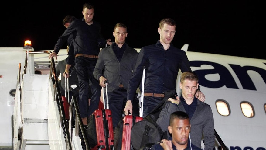Germany's soccer players arrive at the International airport in Salvador, Brazil, Sunday, June 8, 2014. Germany's national soccer team arrived in Salvador to continue their preparations for the upcoming 2014 World Cup, which starts on June 12. (AP Photo/Raul Spinasse)