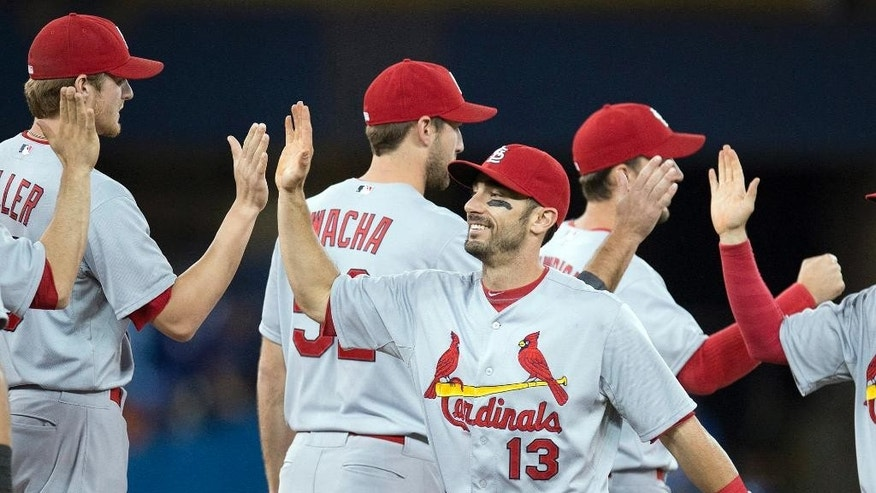 St. Louis Cardinals Matt Carpenter (13) celebrates with teammates after defeating the Toronto Blue Jays 5-0 in a baseball game in Toronto on Sunday June 8, 2014. (AP Photo/the Canadian Press, Frank Gunn)