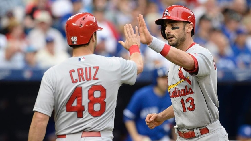 St. Louis Cardinals' Matt Carpenter, right, and Tony Cruz celebrate Carpenter's two-run home run against the Toronto Blue Jays during the second inning of a baseball game in Toronto, Sunday, June 8, 2014. (AP Photo/The Canadian Press, Frank Gunn)