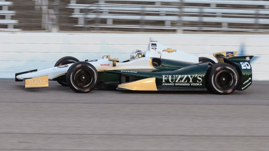 Ed Carpenter drives through Turn 4 during the IndyCar auto race at Texas Motor Speedway in Fort Worth, Texas, Saturday, June 7, 2014. (AP Photo/Larry Papke)