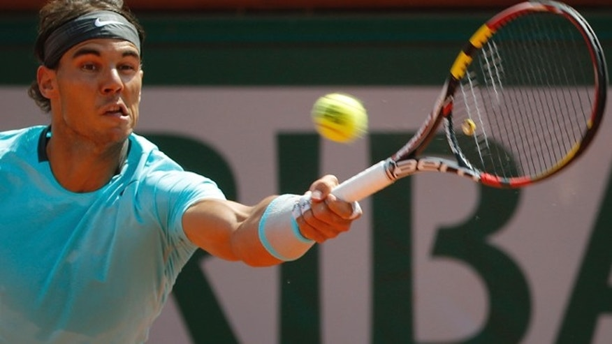 June 8, 2014: Spain's Rafael Nadal returns the ball during the final of the French Open tennis tournament against Serbia's Novak Djokovic at the Roland Garros stadium, in Paris, France. (AP)