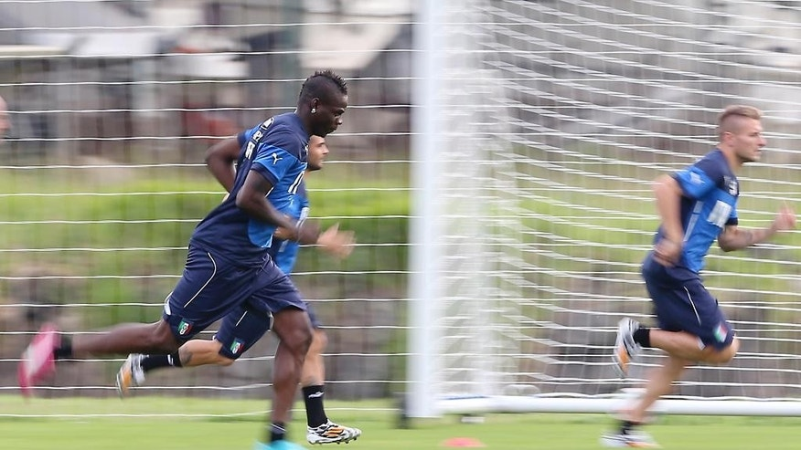 Italy forward Mario Balotelli, left front, forward Lorenzo Insigne and forward Ciro Immobile, right, run sprints during a training session for the upcoming World Cup at the Portobello training center in Mangaratiba, Brazil, Friday, June 6, 2014. Italy is part of Group D that includes Costa Rica, England and Uruguay. Italy will play England in Manaus in its opening match on June 14. (AP Photo/Antonio Calanni)