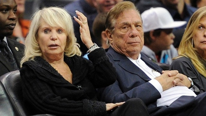 Nov. 12, 2010: Shelly Sterling sits with her husband, Donald Sterling, right, during the Los Angeles Clippers' NBA basketball game against the Detroit Pistons in Los Angeles. (AP/Mark J. Terrill, File)
