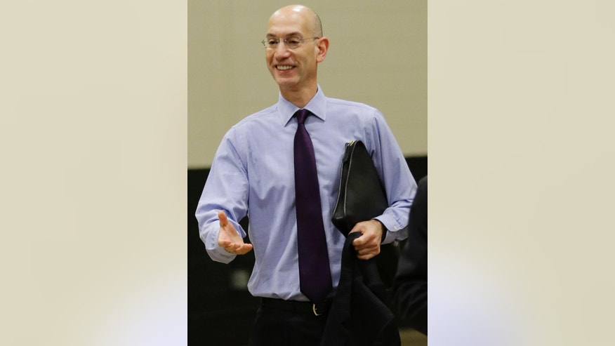 NBA Commissioner Adam Silver arrives before Game 2 of the NBA basketball finals between the San Antonio Spurs and the Miami Heat, on Sunday, June 8, 2014, in San Antonio. (AP Photo/Eric Gay)