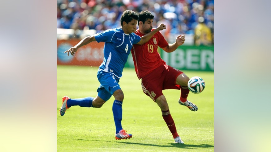 El Salvador's Jonathan Barrios (4) and Spain's Diego Costa (19) battle for the ball during the first half of an exhibition soccer game, Saturday, June 7, 2014, in Landover, Md. Spain won 2-0. (AP Photo/Luis M. Alvarez)