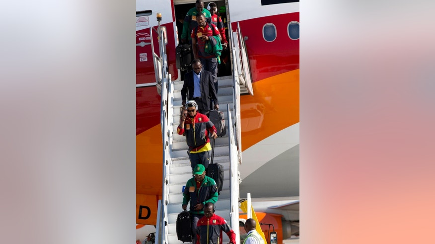 Cameroon national team players arrive at the Galeao Air Base in Rio de Janeiro, Brazil, Monday, June 9, 2014. Cameroon's World Cup team refused to board a plane due to take them to Brazil on Sunday because of a long-running dispute over bonus payments for the tournament, forcing their national federation to take out a loan to meet their demands. (AP Photo/Rodrigo Abd)