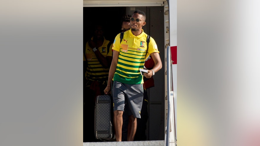 Chelsea's player Samuel Eto'o leaves the aircraft  as Cameroon's national team at the Galeao Air Base in Rio de Janeiro, Brazil, Monday, June 9, 2014. Cameroon's World Cup team refused to board a plane due to take them to Brazil on Sunday because of a long-running dispute over bonus payments for the tournament, forcing their national federation to take out a loan to meet their demands. (AP Photo/Rodrigo Abd)