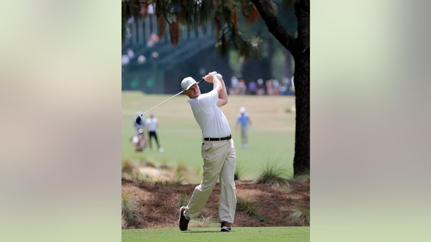 Ernie Els, of South Africa, watches his tee shot on the second hole during a practice round for the U.S. Open golf tournament in Pinehurst, N.C., Monday, June 9, 2014. (AP Photo/Chuck Burton)