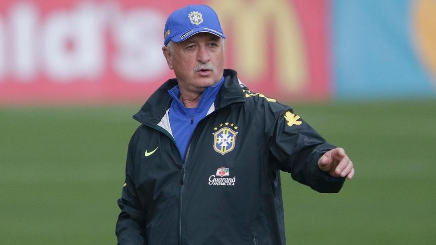 Brazil's coach Luiz Felipe Scolari directs his players during a training session of the Brazilian national socccer team at the Granja Comary training center in Teresopolis, Brazil, Monday, June 9, 2014. Brazil plays in group A of the 2014 soccer World Cup. (AP Photo/Andre Penner)