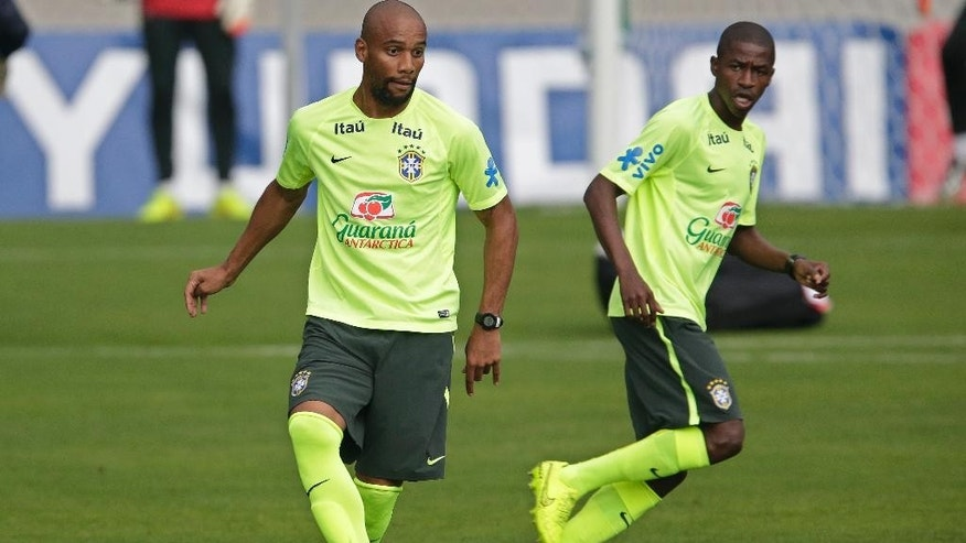 Brazil's Maicon, left, and Ramires practice during a training session of the Brazilian national soccer team, at the Granja Comary training center in Teresopolis, Brazil, Monday, June 9, 2014. Brazil plays in group A of the 2014 soccer World Cup. (AP Photo/Andre Penner)