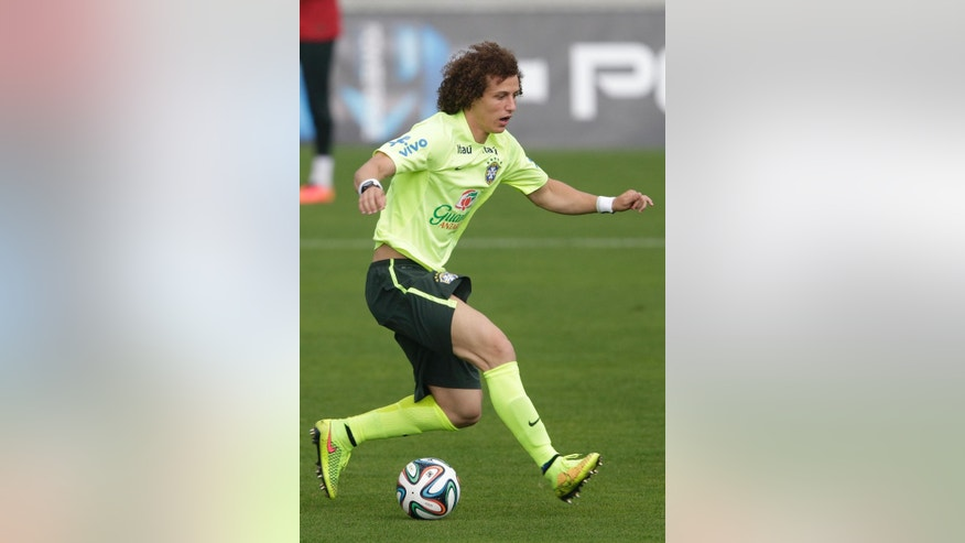 Brazil's David Luiz practices during a training session of the Brazilian national soccer team, at the Granja Comary training center in Teresopolis, Brazil, Monday, June 9, 2014. Brazil plays in group A of the 2014 soccer World Cup. (AP Photo/Andre Penner)