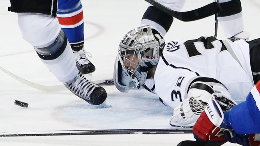 Los Angeles Kings goalie Jonathan Quick (32) follows the rebound after blocking a shot against the New York Rangers in the second period during Game 3 of the NHL hockey Stanley Cup Final, Monday, June 9, 2014, in New York. (AP Photo/Kathy Willens)