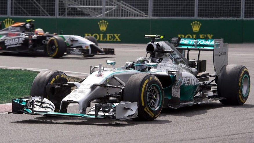 Mercedes driver Nico Rosberg from Germany races to a second-place finish during the race Sunday, June 8, 2014, at the Canadian Grand Prix in Montreal. Force India driver Nico Hulkenberg from Germany is behind. (AP Photo/The Canadian Press, Jacques Boissinot)