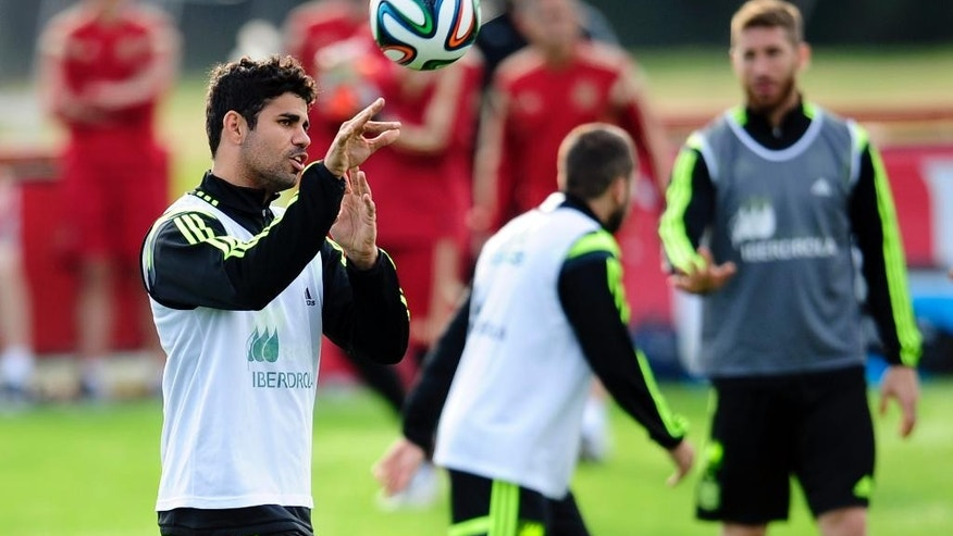 CORRECTS SPELLING OF COSTA - Spain's Diego Costa throws the ball during a training session at the Atletico Paranaense training center in Curitiba, Brazil, Monday, June 9, 2014. Spain will play in group B of the Brazil 2014 World Cup. (AP Photo/Manu Fernandez)