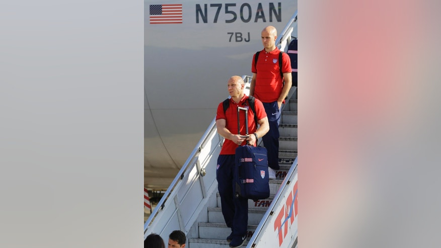 United States' national soccer team goalkeeper Brad Friedel, bottom, and Michael Bradley arrives at the Sao Paulo International airport in Brazil, Monday, June 9, 2014. The U.S. team arrived in Sao Paulo to continue their preparations for the upcoming Brazil 2014 World Cup, which starts on June 12. (AP Photo/Nelson Antoine)